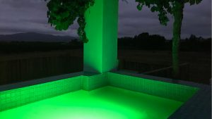 Pool lit by green light at theLAB LIFESTYLE guest house